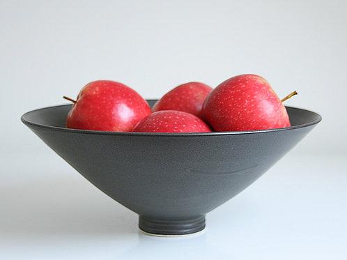 A large bowl in dark grey