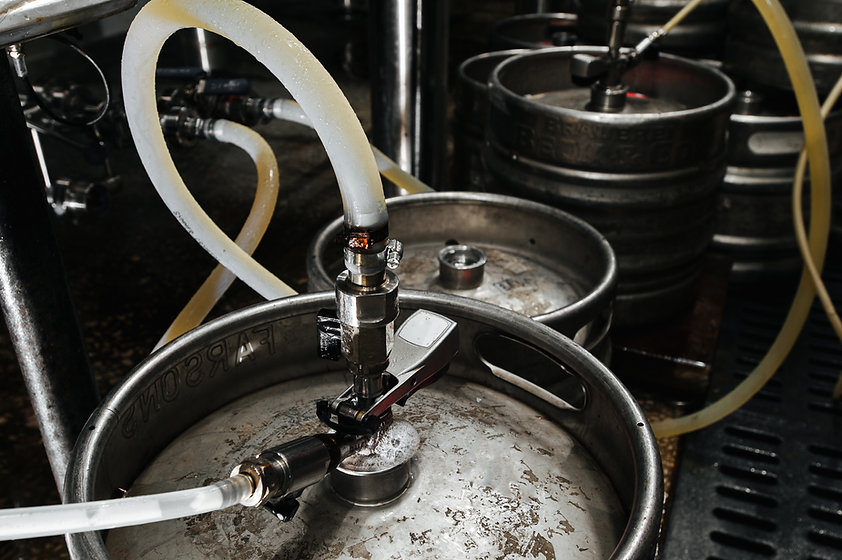 Many metal kegs of beer in beer plant. B