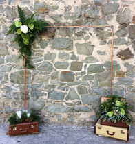 Copper Arch with suitcases