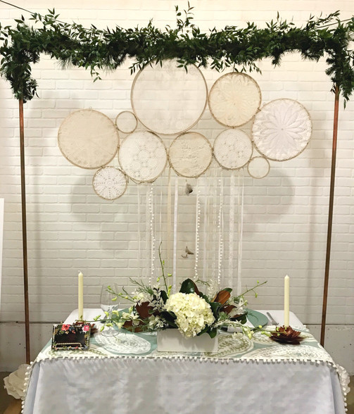 Copper Arch with BOHO backdrop behind sweetheart table