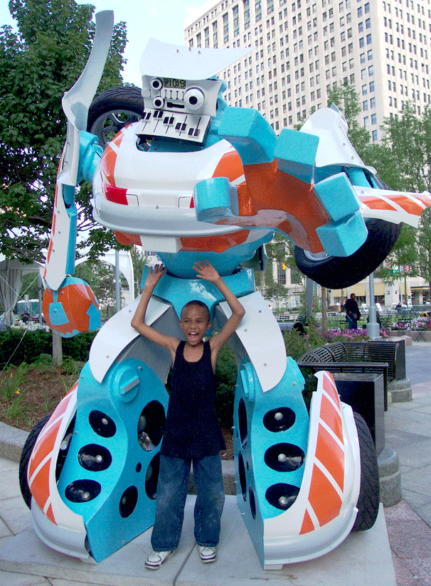 """12 feet tall  """"All Your Bass Are Belong to Us"""" was chosen as one of 102 colorful, car-shaped sculptures with musical themes featured in the CarTunes on Parade public art exhibit on the streets of Detroit and Windsor in the summer of 2005. CarTunes on Parade was produced by the YMCA of Metropolitan Detroit and the Windsor Endowment for the Arts, and was sponsored by DaimlerChrysler, Ford and General Motors. All the sculptures where auctioned off to benefit local charities and the artists who created them."""