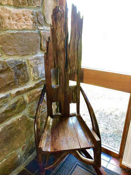Rustic wooden chair in the entrance hall