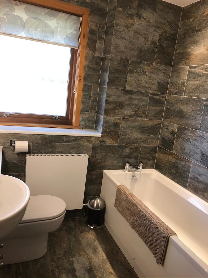 Bathroom - fully tiled in stone