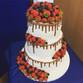 Drip cake wedding cake with fresh berries