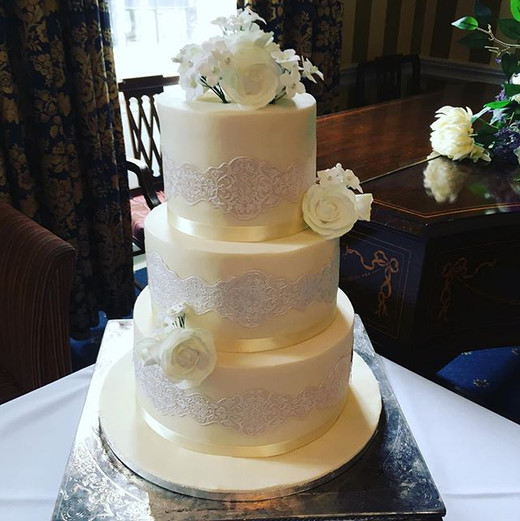Ivory and lace wedding cake at The Norfolk Arms Arundel