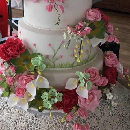 handmade sugar flowers on a floral wedding cake