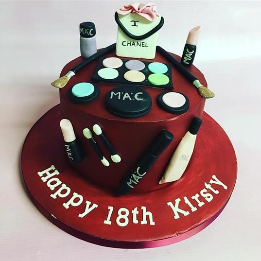 make up cake. 18th birthday cake, red birthday cake, teenage girl birthday cake, custom cake, luxury birthday cake, happy 18th cake, 18th cake, teenage cake, make up and bag cake, make up artist cake, nail varnish cake, mac makeup cake