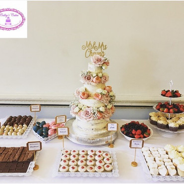 semi naked wdding cake and dessert table at Buxted Park