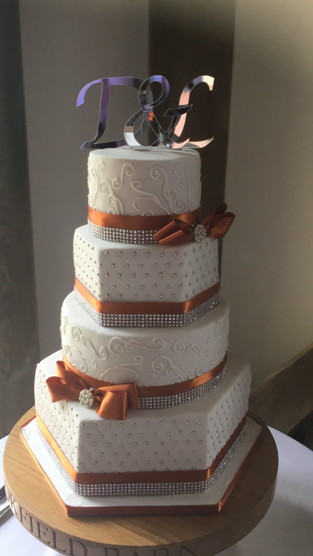 white and burnt orange wedding cake
