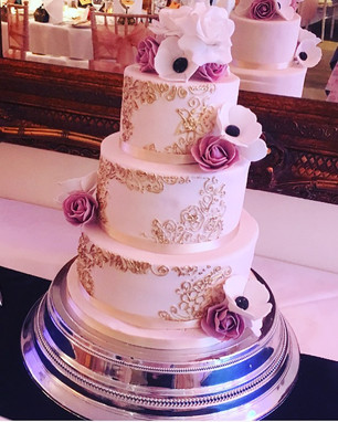 gold and pink wedding cake with sugar flowers at Tottington Manor