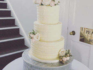 Buttercream wedding cakes with fresh flowers by Calley's Cakes Sussex
