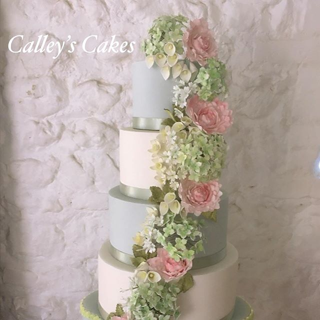 Spring flower cascade wedding cake