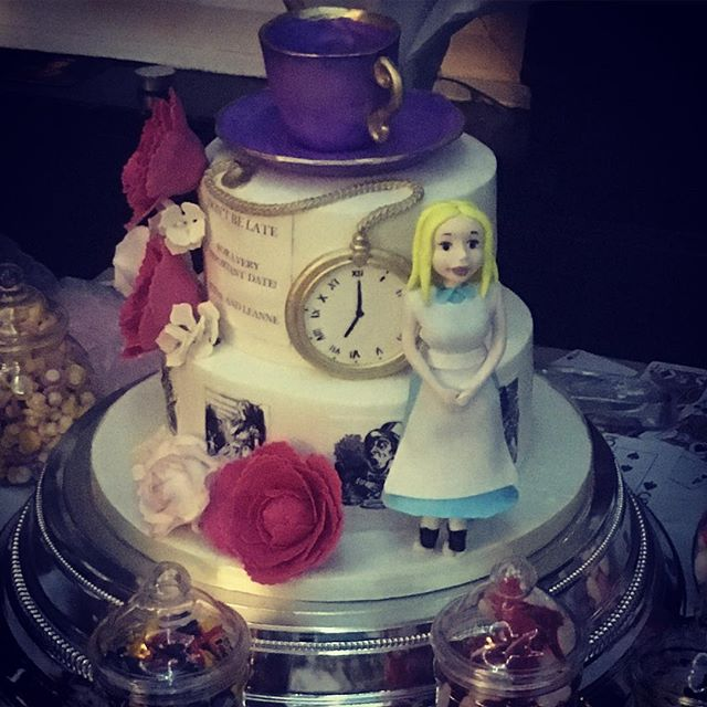 Themed wedding cake with Alice