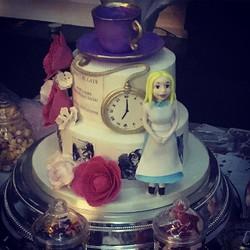 Themed wedding cake with Alice