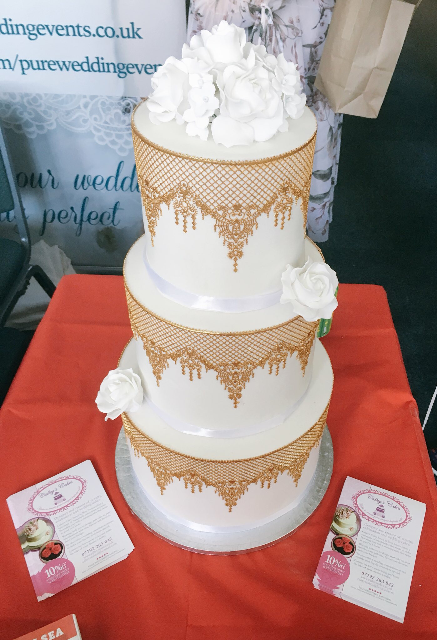 white and gold cake lace wedding cak