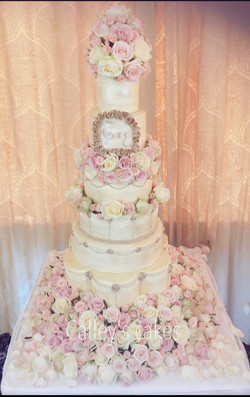 Ivory and rose gold 7 tier cake