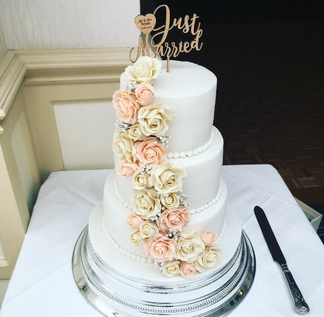 ivory and peach rose wedding cake
