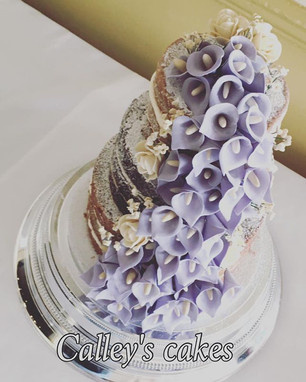 naked wedding cake with sugar cala lily's