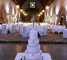 Four tier silver and white wedding cake at Ashdown park hotel and country club in Sussex