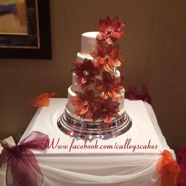 orange and burgundy wedding cake