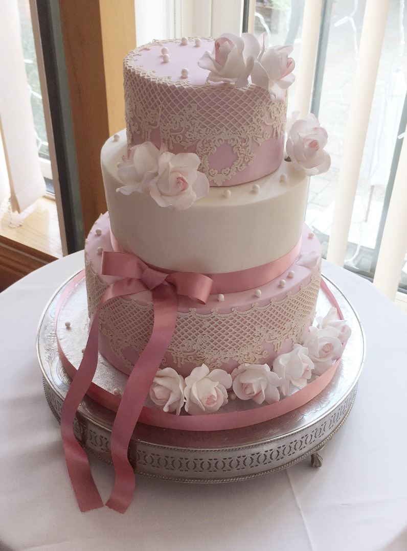 Pink lace and pearl wedding cake