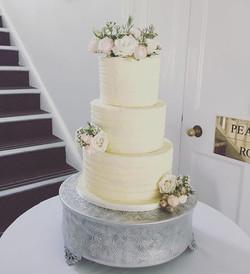 buttercream wedding cake with flower