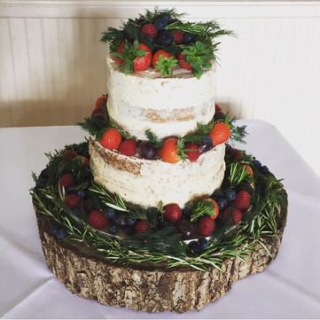 semi naked wedding cake with herbs and berries at Highley Manor