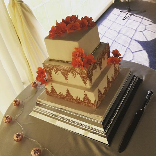 Gold cake lace and orchid wedding cake at Slaugham Place