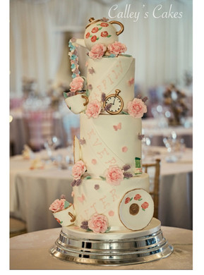alice in wonderland wedding cake, alice in wonderland, double barreled wedding cake, teapot wedding cake, pouring teapot wedding cake, pretty wedding cake, luxury wedding cake, themed wedding cake, Selden Barns wedding cake, Worthing wedding cake, happily ever after wedding cake, floral wedding cake, wedding cake with butterflies and flowers
