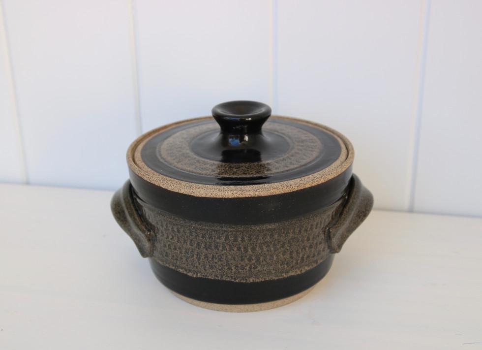 small black covered casserole