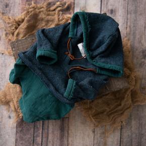 green/teal hooded boy