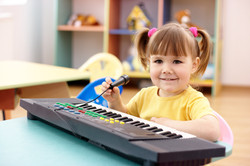Girl With Electronic Piano And Microphone