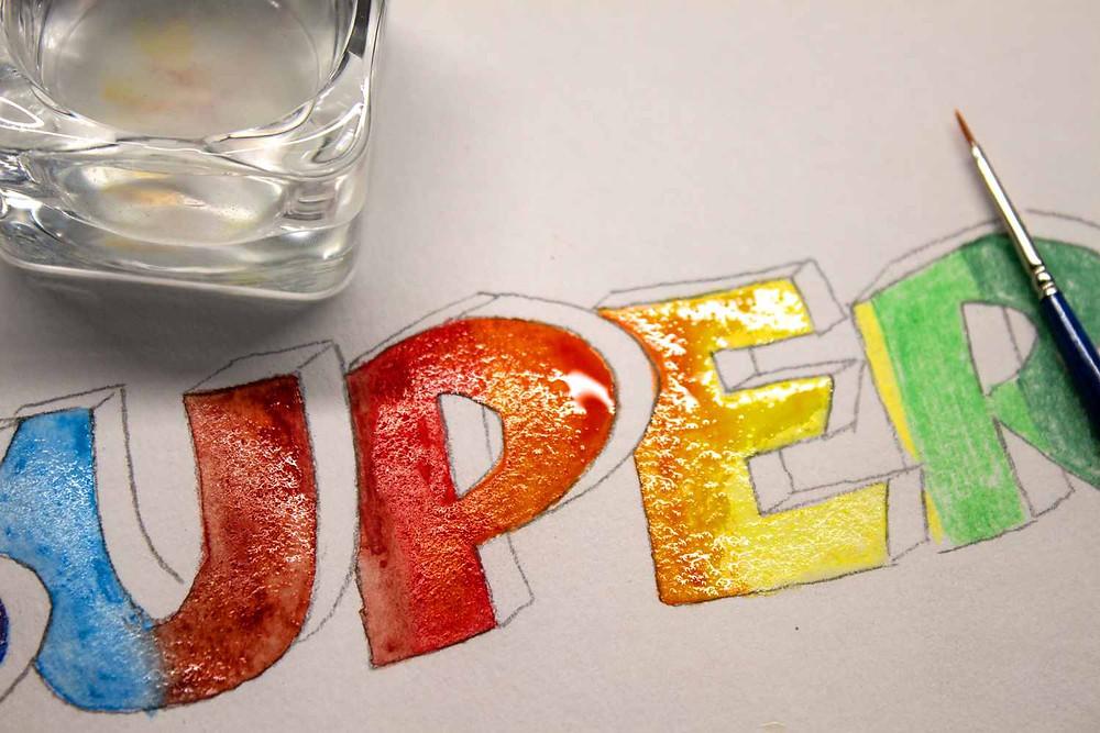 Aquarell-Buntstifte werden nun mit Wasser vermalen