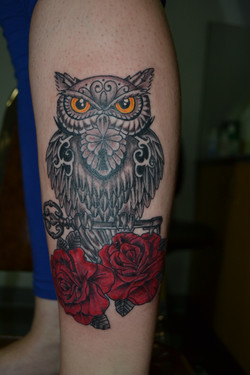 Owl with color rose tattoo