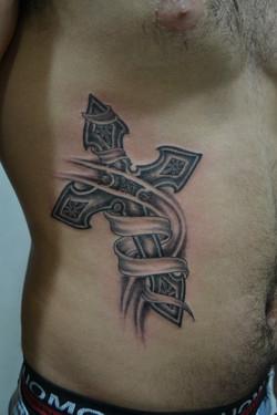 Cross banner tattoo
