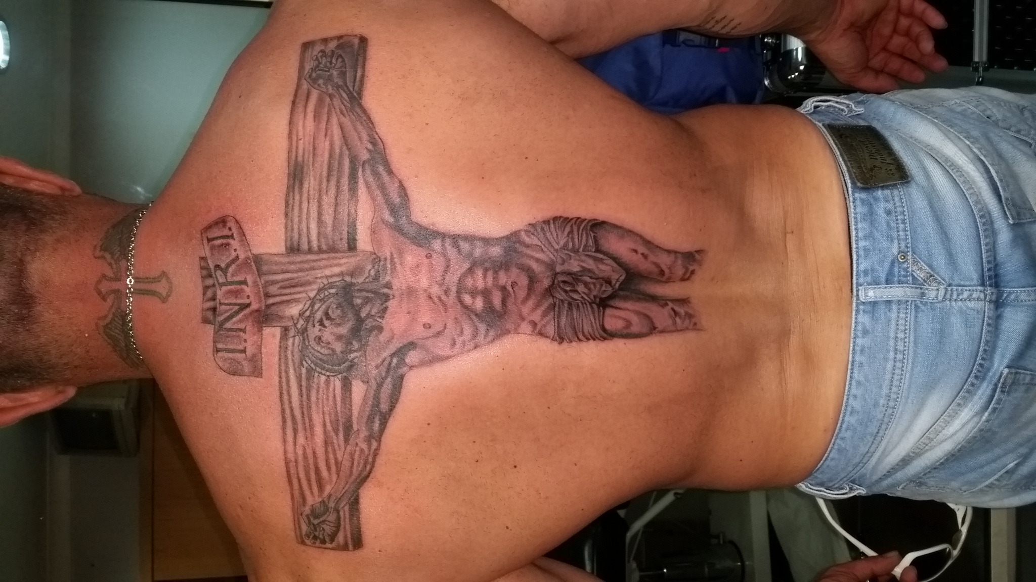 Back piece the cross tattoo