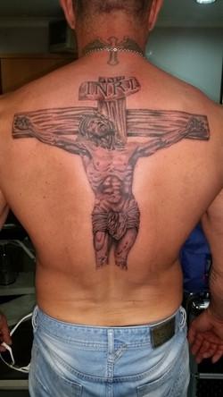 Back piece the cross tattoo