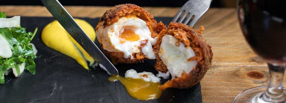Deliciuous scotch egg being eaten