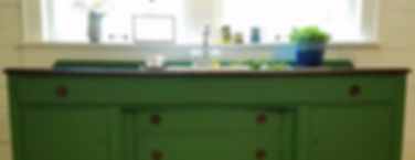 vintage sideboard used as kitchen sink