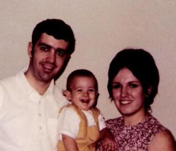 John at 1 year old with parents Bruce and Veronica