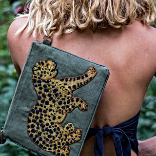 $350  Canvas with hand drawn, one of a kind, glass bead detail. Cotton lining, metal zip with cow horn zipper pull. Each bag is drawn and beaded by hand each piece is one of a kind.   Please Enquire for further details or wholesale.