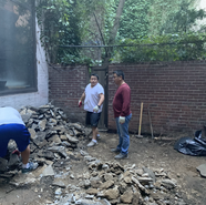 Bhutanese Sangha Members Removing Rocks from Backyard Garden