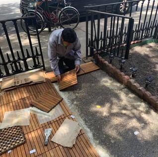 Sangye la setting up the tiles
