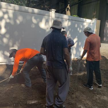 Karmarong preparing ground for bricks to be laid