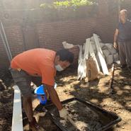 Karmarong preparing materials to renovate the backyard garden