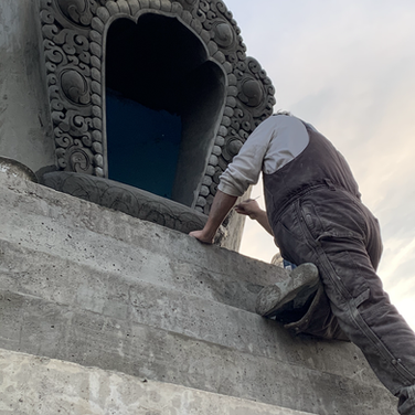 Lopon Jampal finishing the carving for the window of the Stupa's bumpa section