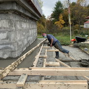 Laying cement for the second layer of the base