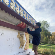 Volunterering Sangha Members breaking the layers of cement and plasters from the stupa