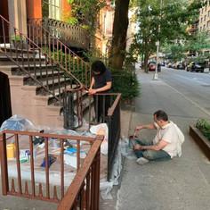 Volunteering Sangha painting the railings