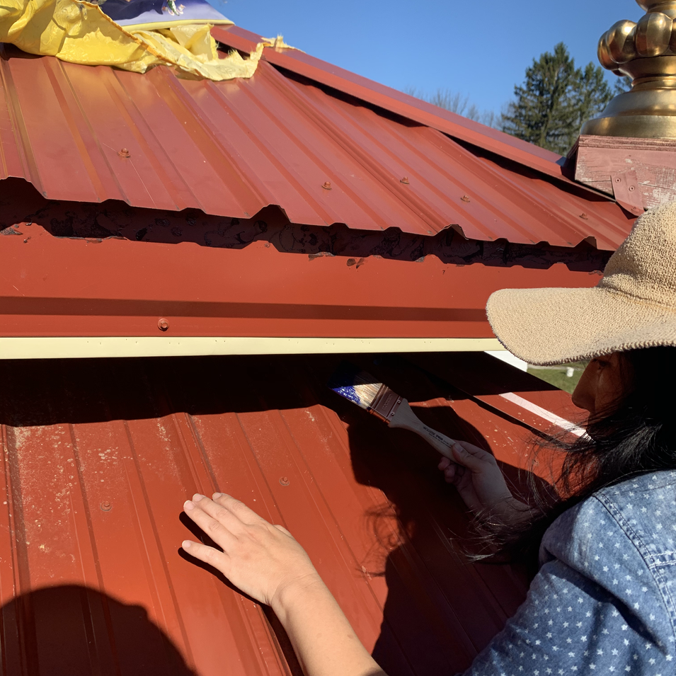 Misun painting the roof of the Temple